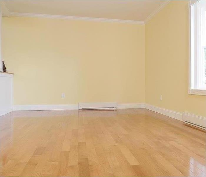 A new living room displayed with new hardwood floors and painted walls & ceilings