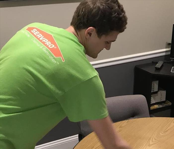 A man cleans an office