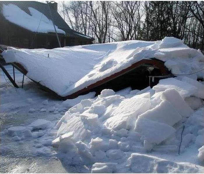 A structure collapsed under the weight of snow