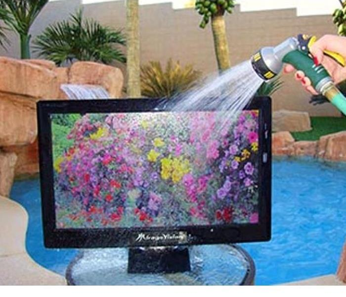 Monitor Sprayed with Water