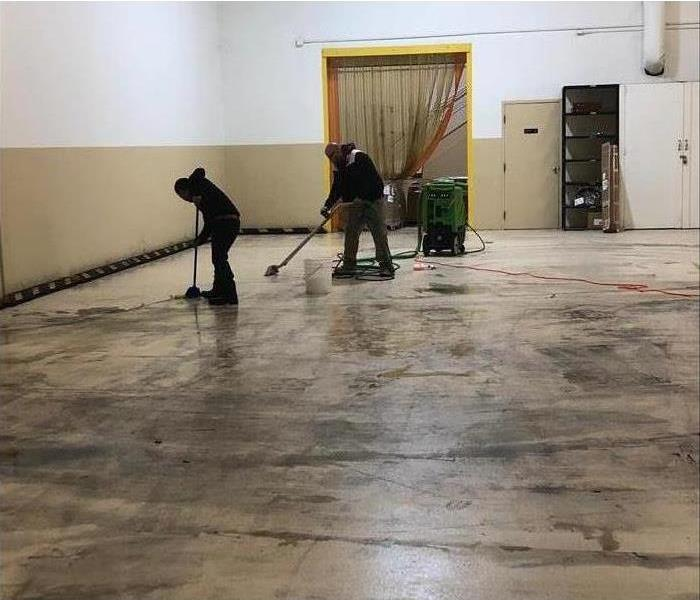The SERVPRO crew cleans a fire-damaged workshop.